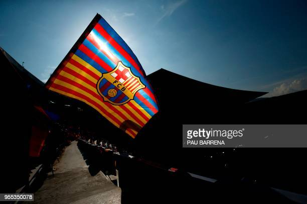 A Barcelona flag flutters before the Spanish league football match between FC Barcelona and Real Madrid CF at the Camp Nou stadium in Barcelona on...