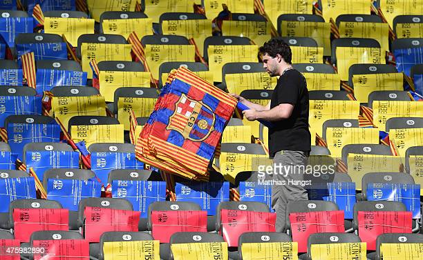 Barcelona flags are laid out on seats on the eve of the UEFA Champions League Final between Juventus and FC Barcelona at Olympiastadion on June 5...