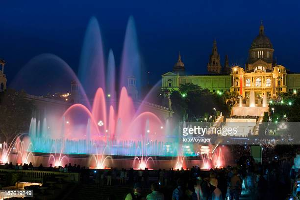 Barcelona Font Màgica MNAC tourists watching colorful fountain night Spain