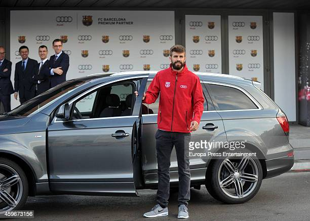 Barcelona Football Club player Gerard Pique receives the keys of the new Audi cars during the presentation of Barcelona Football Club's new cars made...