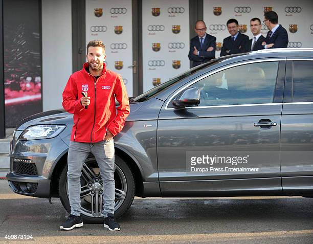 Barcelona Football Club player Jordi Alba receives the keys of the new Audi cars during the presentation of Barcelona Football Club's new cars made...