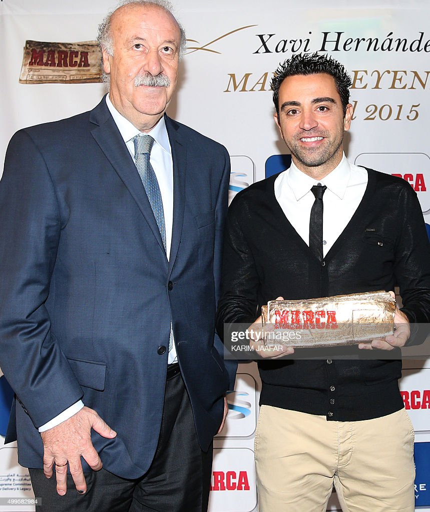 barcelona football legend and qatar s al sadd player xavi  barcelona football legend and qatar s al sadd player xavi hernandez poses for photographers
