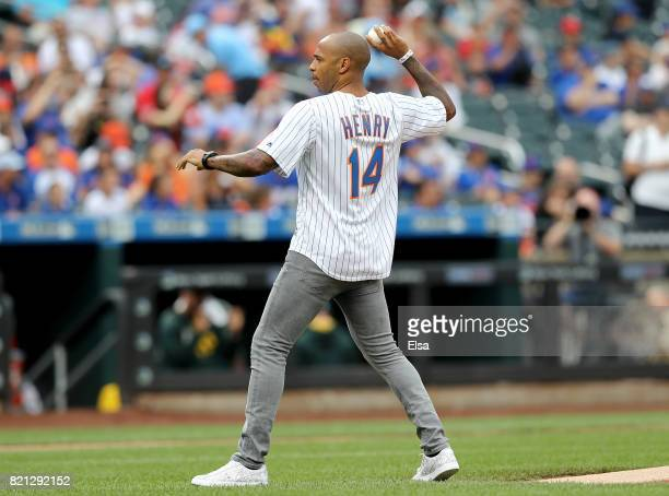 Barcelona football legend Thierry Henry throws out the ceremonial first pitch before the game between the New York Mets and the Oakland Athletics on...