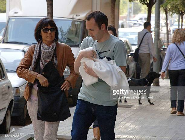 Barcelona football player Andres Iniesta and his wife Ana Ortiz are sighted with their daughter Valeria on April 28 2011 in Barcelona Spain