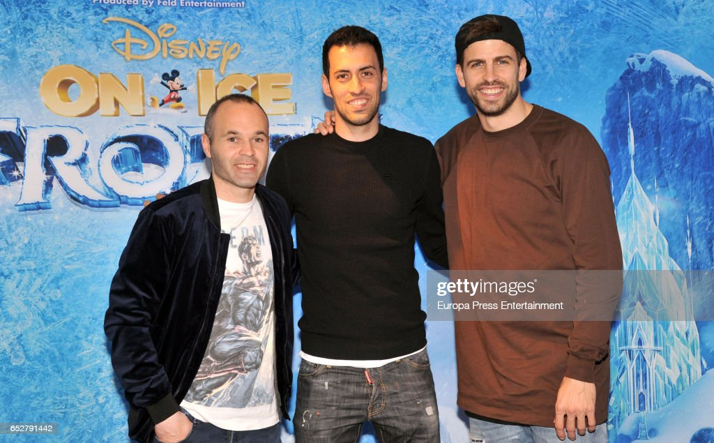 Barcelona football player Andres Iniesta, Sergio Busquets and Gerard Pique attend 'Disney On Ice' on March 10, 2017 in Barcelona, Spain.