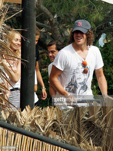 Barcelona football player Carles Puyol and Vanessa Lorenzo are seen on July 19 2014 in Ibiza Spain