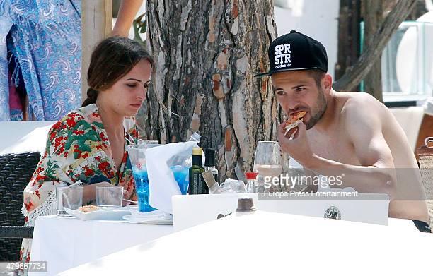 Barcelona football player Jordi Alba and Romarey Ventura are seen on July 4 2015 in Ibiza Spain