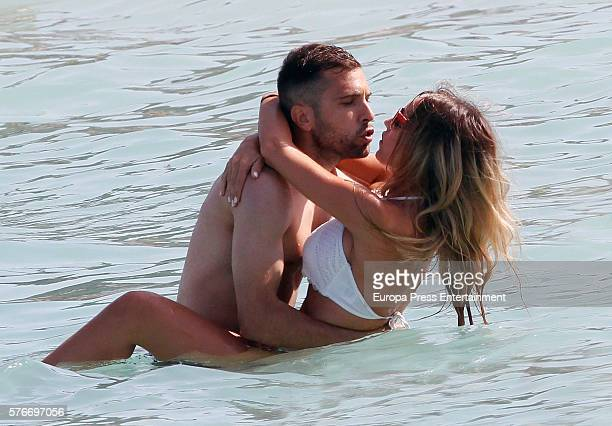 Barcelona football player Jordi Alba and Romarey Ventura are seen on July 3 2016 in Ibiza Spain