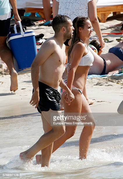 Barcelona football player Jordi Alba and Romarey Ventura are seen on July 3 2016 in Ibiza Spain