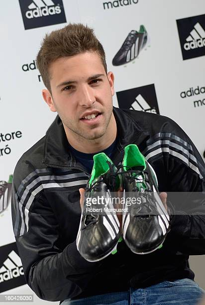 Barcelona football player Jordi Alba presents the latest Adidas F50 shoe at the Adidas Mataro Park Commercial store on January 31 2013 in Mataro Spain