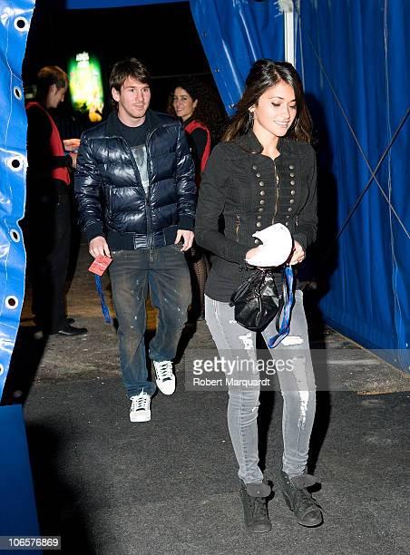Barcelona football player Leonel Messi and girlfriend Antonella Roccuzzo arrive late for the Cirque du Soleil 'Varekai' show on November 5 2010 in...