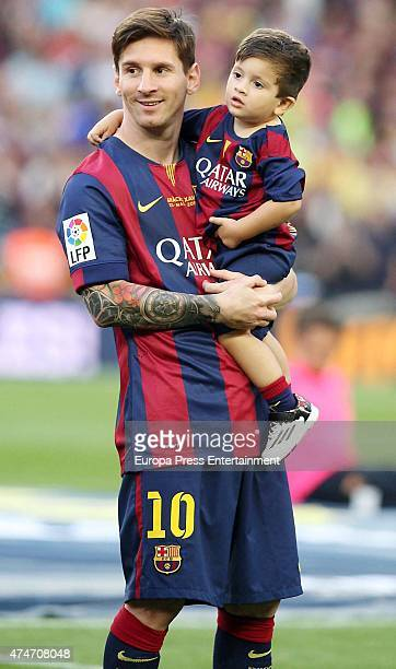 Barcelona Football player Lionel Messi and his son Thiago Messi celebrate winning the Spanish League at Camp Nou on May 23 2015 in Barcelona Spain