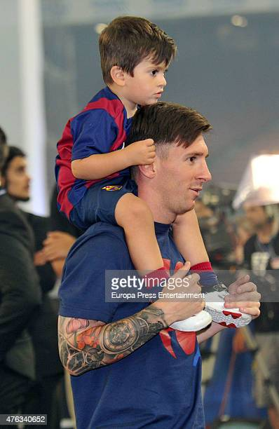 Barcelona football player Lionel Messi and son Thiago Messi celebrate victory in the UEFA Champions League Final on June 7 2015 in Barcelona Spain