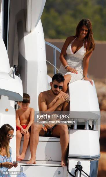 Barcelona football player Lionel Messi's wife Antonella Roccuzzo and her son Thiago Messi are seen on July 17 2018 in Ibiza Spain