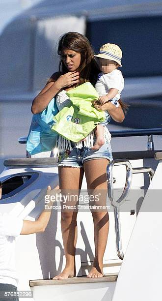 Barcelona football player Lionel Messi's wife Antonella Rocuzzo and her son Mateo Messi are seen on July 16 2016 in Ibiza Spain