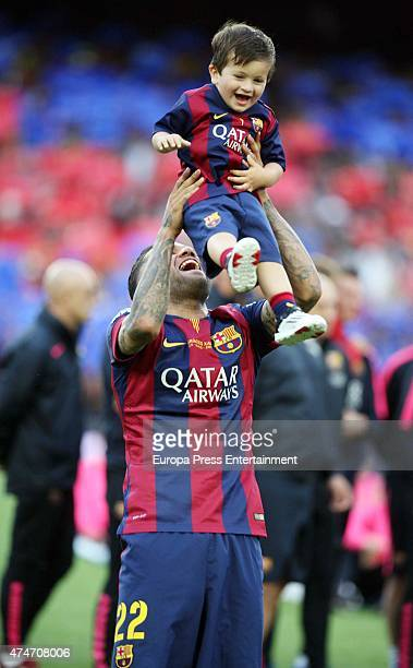 Barcelona Football player with Lionel Messi's son Thiago Messi celebrates winning the Spanish League at Camp Nou on May 23 2015 in Barcelona Spain