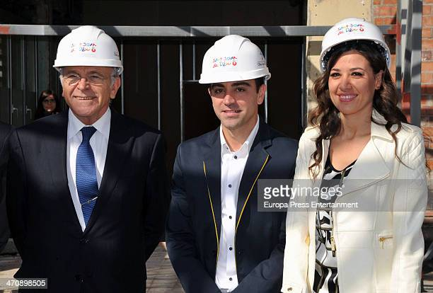 Barcelona football player Xavi Hernandez his wife Nuria Cunillera and president of 'La Caixa' Isidro Faine present Oncology Children Hospital San...