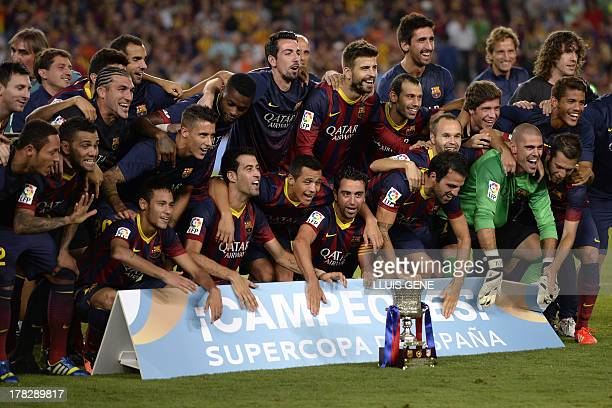 Barcelona football players celebrate their victory at the end of the Spanish Super Cup second leg football match FC Barcelona vs Atletico Madrid at...