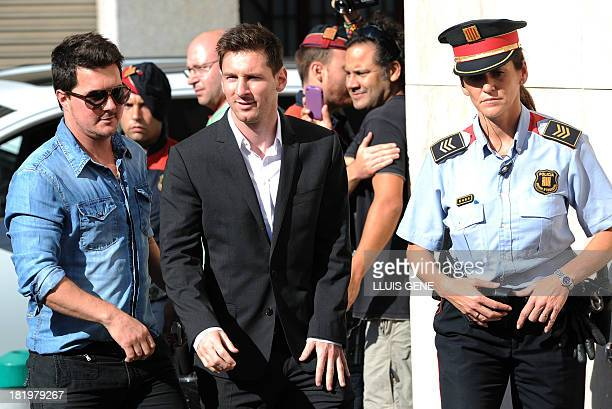 Barcelona football star Lionel Messi and his brother Rodrigo arrive to the courhouse in the coastal town of Gava near Barcelona on September 27 2013...