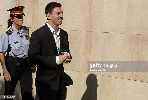 Barcelona football star Lionel Messi arrives to the courhouse in the coastal town of Gava near Barcelona on September 27 2013 to face judges on tax...