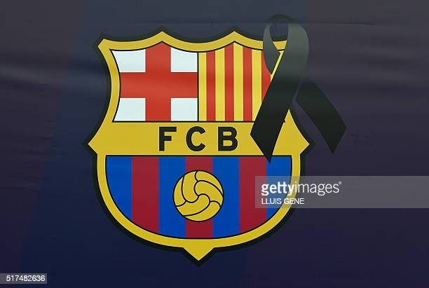 A Barcelona football team logo marked with a black sash is pictured on 25 March 2016 at Camp Nou stadium in Barcelona a day after the death of...