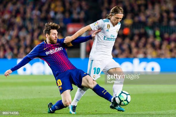 FC Barcelona forward Lionel Messi and Real Madrid midfielder Luka Modric during the match between FC Barcelona v Real Madrid for the round 36 of the...