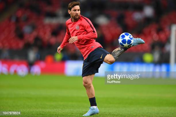 Barcelona forward Lionel Messi warms up with a few skills during the UEFA Champions League match between Tottenham Hotspur and FC Barcelona at...