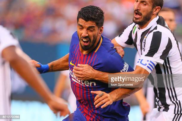 Barcelona forward Luis Suarez battles Juventus defender Giorgio Chiellini during the second half of the International Champions Cup soccer game...