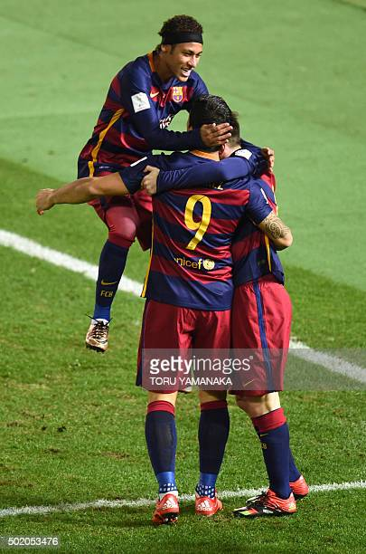 Barcelona forward Luis Suarez celebrates his goal with Barcelona forward Lionel Messi and Barcelona forward Neymar during the Club World Cup football...