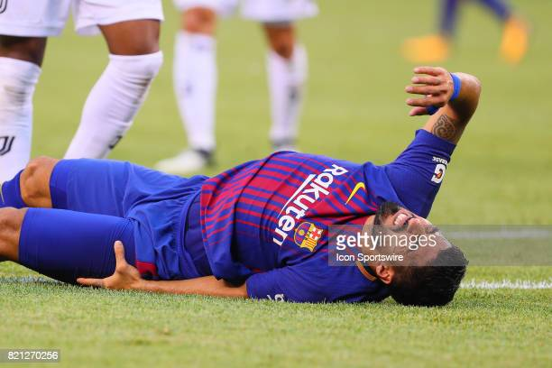 Barcelona forward Luis Suarez in pain after being taken down by Juventus defender Giorgio Chiellini during the second half of the International...