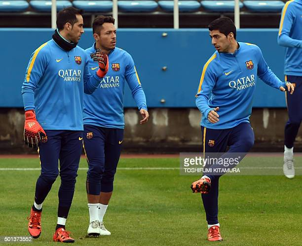 FC Barcelona forward Luis Suarez works out beside defender Adriano and goalkeeper Claudio Bravo during their training session at the Club World Cup...