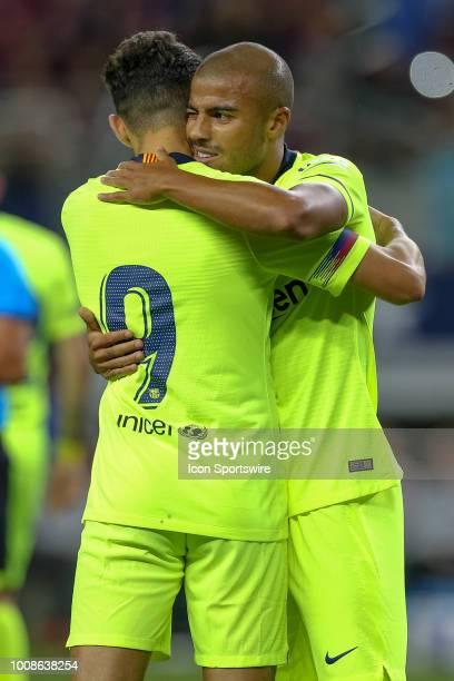Barcelona forward Munir el Haddadi embraces midfielder Rafael Alcantara 'Rafinha' after Rafinha scores during the International Champions Cup between...