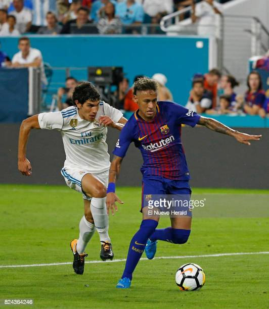 Barcelona forward Neymar vies with Real Madrid defender Jesus Vallejo left during the second half of ''El Clasico Miami'' as part of the...