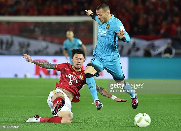 Barcelona forward Sandro Ramirez and defender Zhang Linpeng fight for the ball during their Club World Cup semifinal football match in Yokohama on...