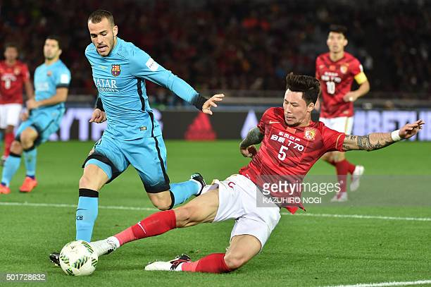 Barcelona forward Sandro Ramirez and Guangzhou Evergrande defender Zhang Linpeng fight for the ball during their Club World Cup semifinal football...