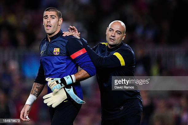 Barcelona goalkeepers coach Jose Ramon de la Fuente and Victor Valdes of FC Barcelona look on during the warm up prior to the UEFA Champions League...