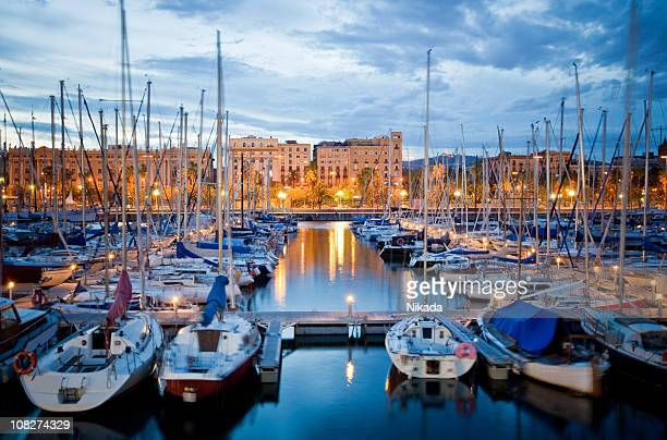 barcelona harbor at dusk - barcelona spain stock photos and pictures
