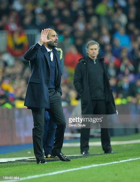 Barcelona head coach Josep Guardiola directs his team near Real Madrid head coach Jose Mourinho during the La Liga match between Real Madrid and...