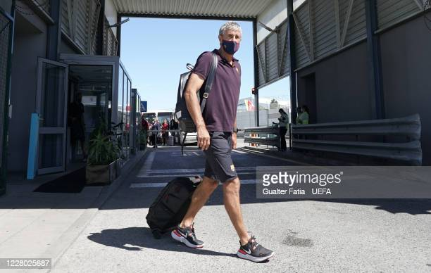 Barcelona head coach Quique Setien arrives with Barcelona team in Lisbon for the Champions League at Humberto Delgado Airport on August 13 2020 in...