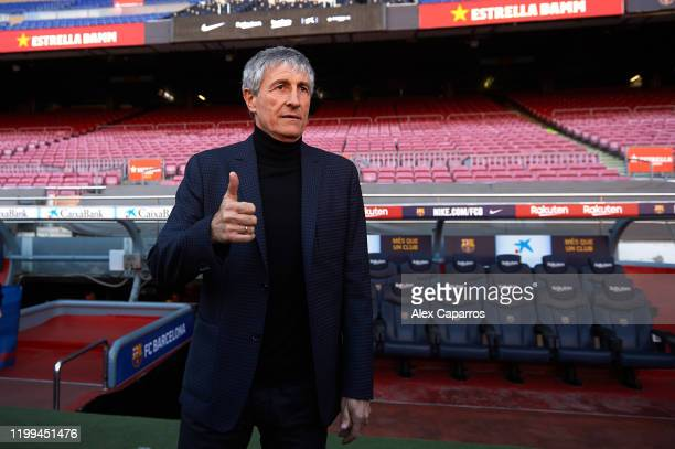Barcelona Head Coach Quique Setien poses for the media as he is unveiled as new FC Barcelona Coach at Camp Nou on January 14 2020 in Barcelona Spain