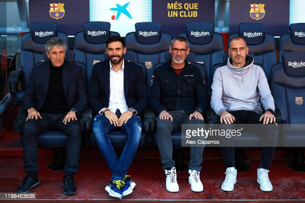 Barcelona Head Coach Quique Setien poses for the media with Assistant Coach Eder Sarabia Goalkeeper Coach Jon Pascua and Physical Trainer Fran Soto...