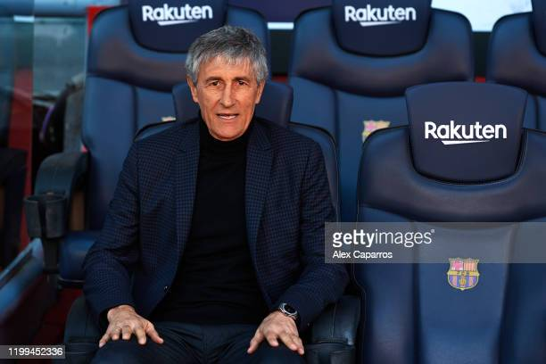 Barcelona Head Coach Quique Setien sits on the bench and poses for the media as he is unveiled as new FC Barcelona Coach at Camp Nou on January 14...
