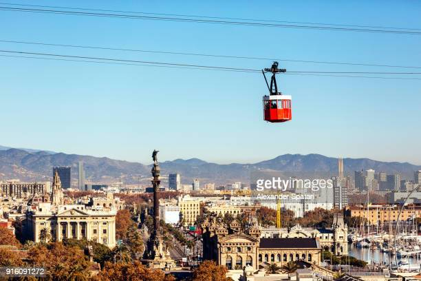 barcelona high angle view skyline with and red cable car - barcelona spanien stock-fotos und bilder