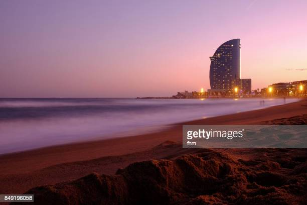 barcelona - idyllic sunset on the beach of la barceloneta (catalonia/ spain) - la barceloneta stock pictures, royalty-free photos & images