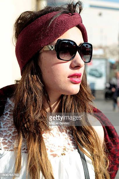 Mayar is wearing an HM turban Tommy Hilfiger shawl Pimkie blouse Zara leggins Timberland boots Burberry sunglasses and Moschino handbag at Plaça...