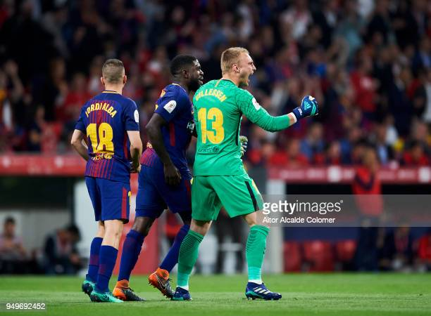 Barcelona keeper Marc Andre ter Stegen celebrates the teams first goal with team mates Samuel Umtiti and Jordi Alba during the Spanish Copa del Rey...