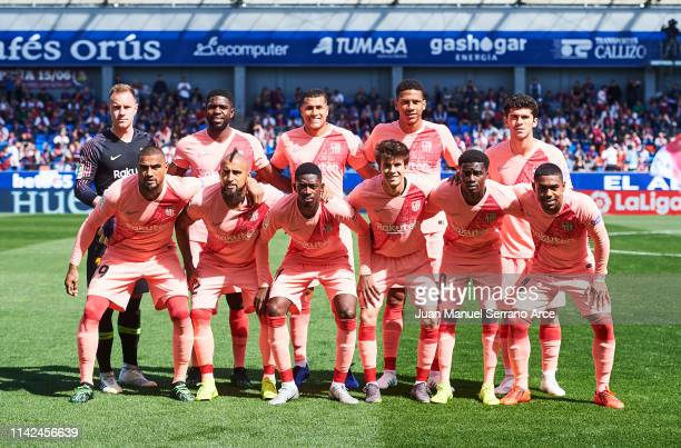 Barcelona line up for a team photo prior to the the La Liga match between SD Huesca and FC Barcelona at Estadio El Alcoraz on April 13 2019 in Huesca...