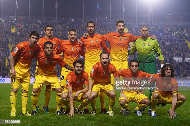 Barcelona line up for a team photograph before the la Liga match between Levante UD and FC Barcelona at Ciutat de Valencia on November 25 2012 in...