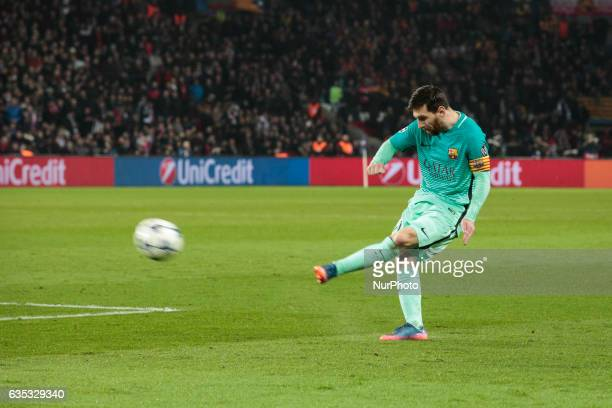 Barcelona Lionel Messi shoots during the UEFA Champions League round of 16 first leg football match between Paris SaintGermain and FC Barcelona on...