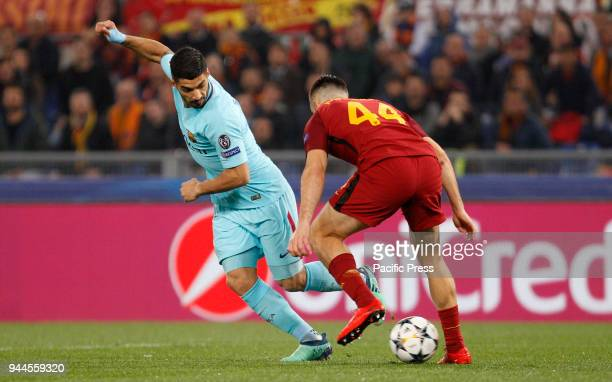 Barcelona Luis Suarez left is challenged by Roma s Kostas Manolas during the Champions League quarter final second leg soccer match between Roma and...